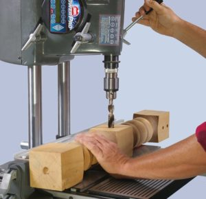 1. Drill press working with wood
