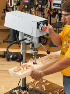 2. Drill press working with wood